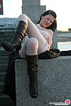 Sizzling hot chick in white pantyhose making spread-eagle right outdoors