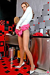 Vivacious chick in flesh-colored pantyhose getting naughty in the kitchen