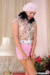 Kinky gal in see-through top and lacy pantyhose putting to work her fingers