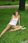 Frisky chick savoring tender tickling of green grass on her pantyhosed slit