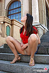 Brightly dressed girl showing she's wearing no panties under her matte hose