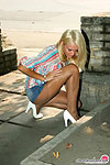 Platinum blonde in elegant shiny pantyhose flashing beaver in public places