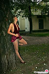 Outdoor tease with playful blonde in shiny pantyhose and short flying skirt