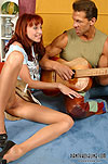 Brawny guy putting aside his guitar and playing with pantyhose clad pussy