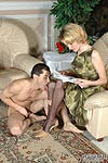 Naked guy worshipping blonde's legs in black pantyhose and getting legjob