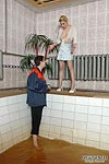 Upskirt teaser in shiny pantyhose luring a repairman into kinky nylon games